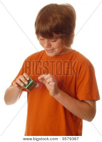 Young Teen Boy Opening Present