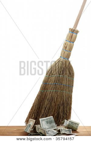 Broom sweep the dollars on white background
