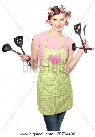 beautiful young housewife with kitchen utensils  isolated on white