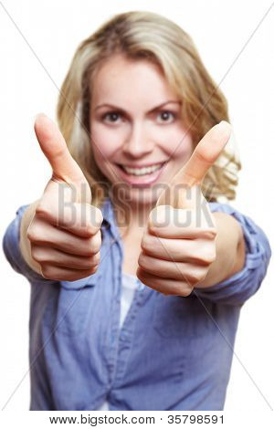 Happy blonde woman holding both of her thumbs up