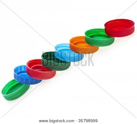 row of colorful plastic bottle cups isolated on white