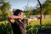 foto of longbow  - Young archer training with the  bow - JPG