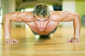 foto of gym workout  - Strong handsome man doing push - JPG