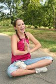 Happy Girl Laughing And Doing Yoga In A Park