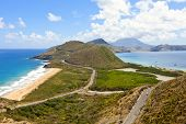 stock photo of greater antilles  - panoramic view of st kitts with nevis in background - JPG