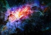 stock photo of outer  - deep outer space background with stars and nebula - JPG