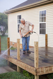 picture of pressure-wash  - Contractor pressure washing deck getting home ready to sell - JPG