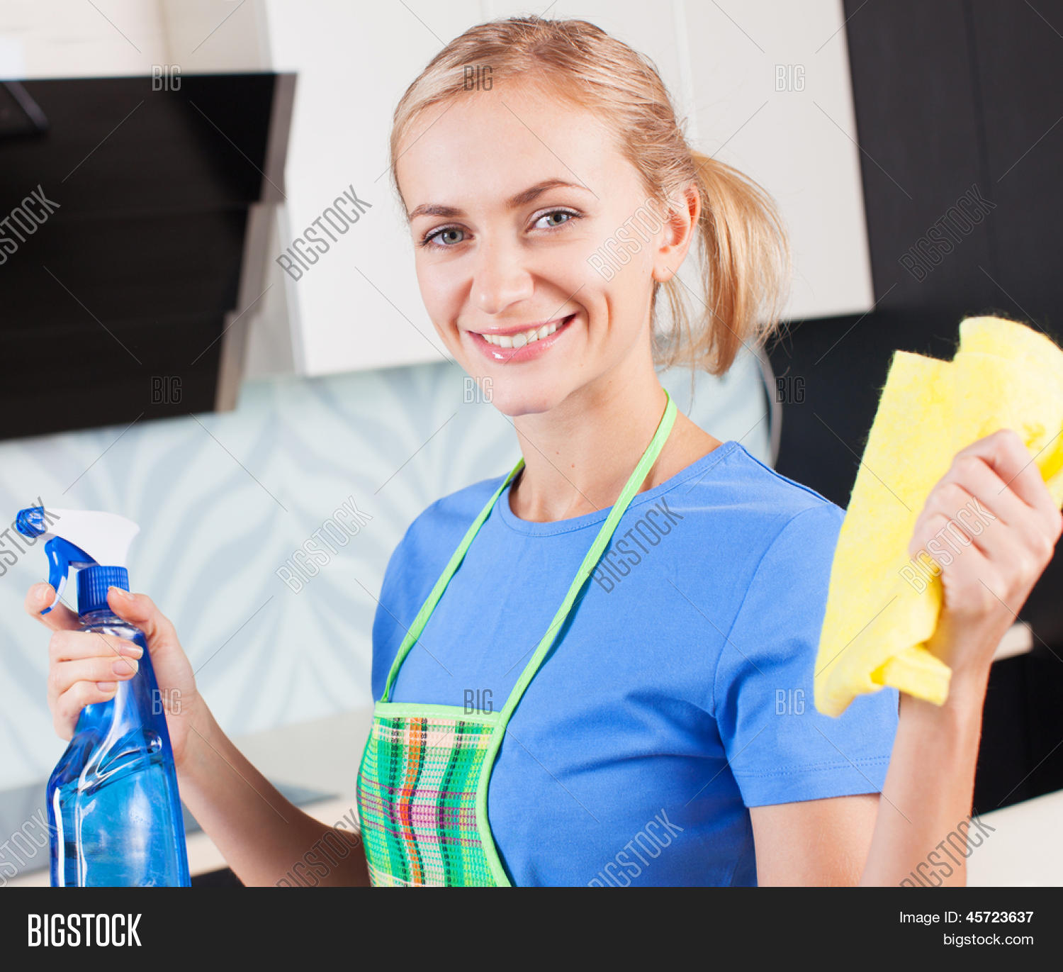 Woman Cleaning Kitchen. Young Woman Image & Photo Bigstock
