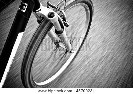 Bicycle in Motion on Road  Black And White Photography Shallow Focus
