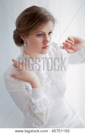 beautiful woman in historical dress on white background