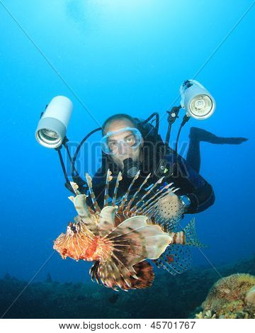 Underwater Photographer Scuba Dives with Lionfish