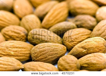 Almond Nuts - Close Up For Pile Of Almond Nuts As Whole Background.