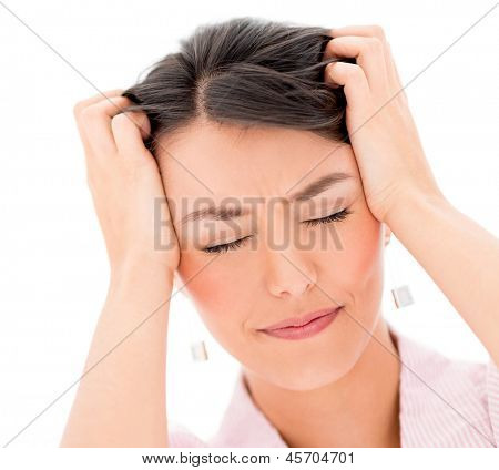 Portrait frustrated woman with a headache - isolated over white background
