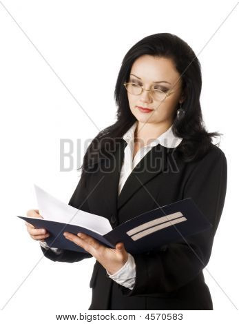Portrait Of Young Business Woman Reading Documents