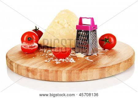 Piece of Parmesan cheese on wooden board isolated on white
