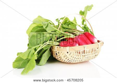 Small garden radish with leaves in wicker basket isolated on white