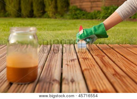Painting wooden patio deck with protective varnish