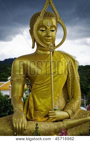 PHUKET, THAILAND - MAY 11: Golden Buddha Statue in the city cemetery on May 11, 2013 in Phuket, Thailand. 95 percent of the population of Thailand is Buddhist.