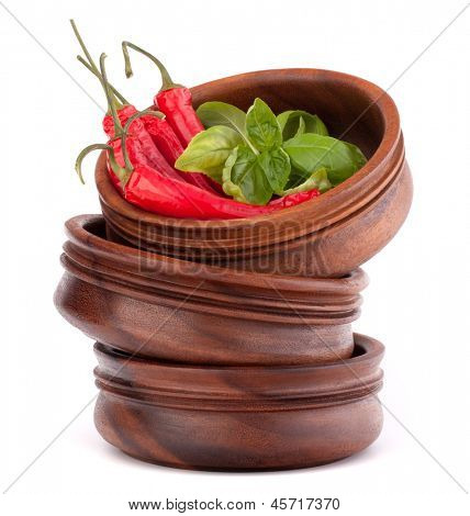 Hot red chili or chilli pepper in wooden bowls stack  isolated on white background cutout