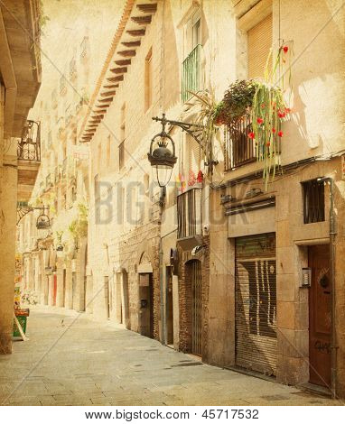 Empty alleyway in Barcelona,  Spain. Carrer de les sitges street . Photo in retro style. Paper texture.
