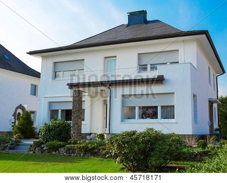 European suburban house against blue sky
