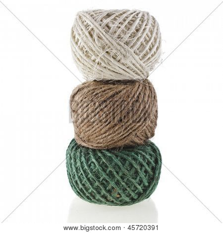 tower stack of colorful household string rope hank bundle texture, isolated on white  background