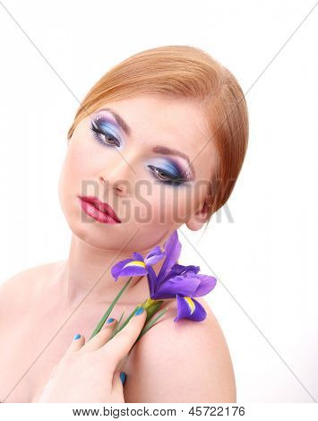 Beautiful young woman with glamour make up and flower, isolated on white