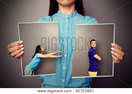 young woman stretching her hands to resentful man