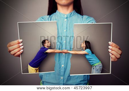 girl holding the torn photo of loving couple