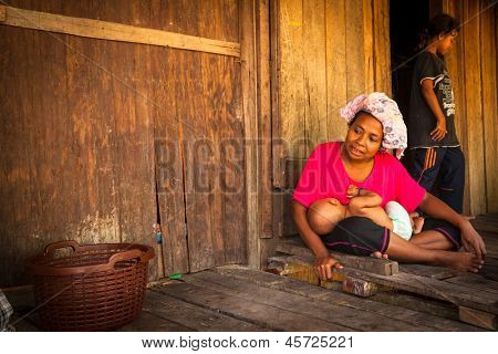 BERDUT, MALAYSIA - APR 8: Unidentified woman Orang Asli in his village on Apr 8, 2013 in Berdut, Malaysia. More than 76% of all Orang Asli live below the poverty line, life expectancy - 53 years old.
