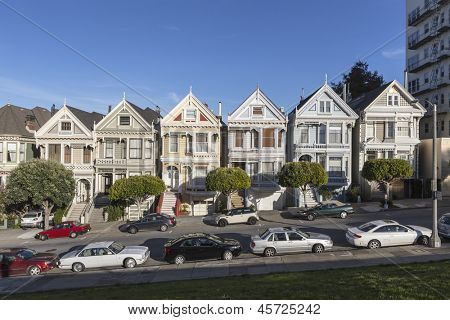 """SAN FRANCISCO, CA - JAN 15: World famous row of Victorian homes known as the """"Painted Ladies"""" on January 15, 2013 in San Francisco, CA"""