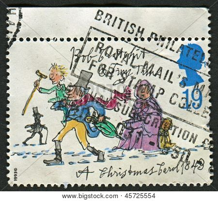 UK - CIRCA 1993: A stamp printed in UK shows image of the Bob Cratchit and Tiny Tim , circa 1993.
