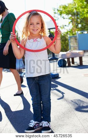 Girl In School Playground With Hoop