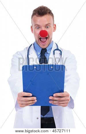 idiot doctor wearing a clowns red nose is amazed by the notes on his clipboard