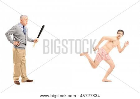 Full length portrait of an angry middle aged man with baseball bat shouting at a shirtless man running away, isolated on white background