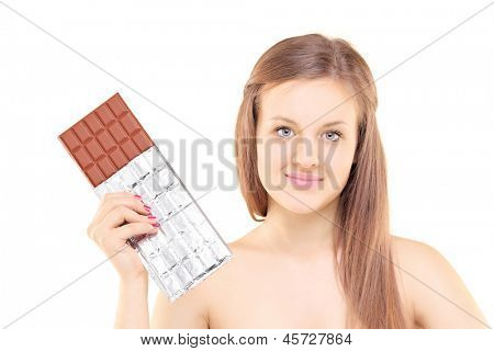 Beautiful young female holding a big chocolate, isolated on white background