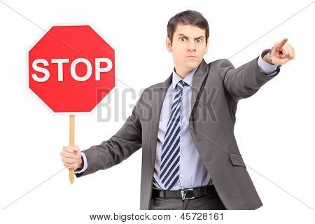 Man in suit holding a stop sign, isolated on white background