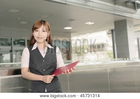 Closeup portrait of Asian business woman hold a file document in Taipei, Taiwan, Asia.