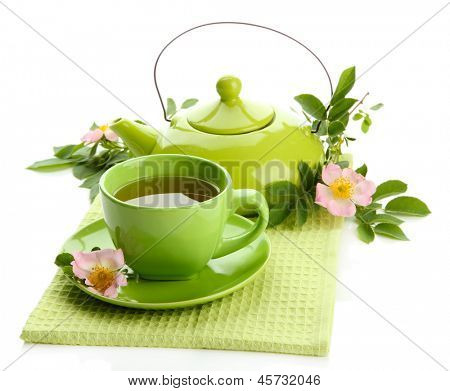 Cup and teapot of herbal tea with hip rose flowers, isolated on white