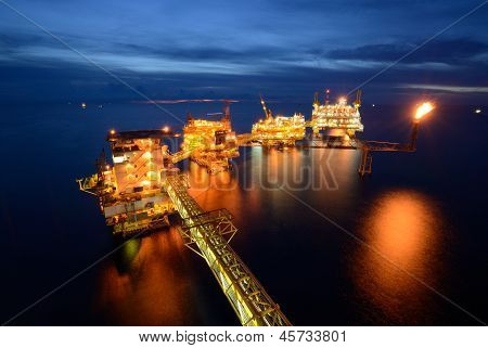 The  Large Offshore Oil Rig Drilling Platform At Night