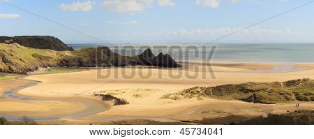A panoramic view of the vast expanse of Three Cliffs Bay on the Gower Peninsula in South Wales, UK