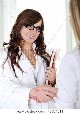 A female doctor standing in modern hospital office