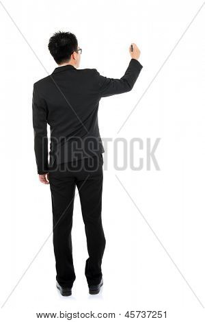 Back view full body picture of an Asian business man writing something on glass boar with marker standing isolated on white background