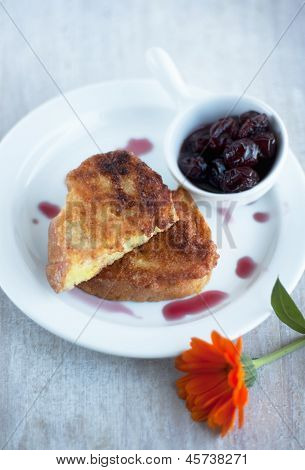 Pieces Of Toasted Bread On The Plate And Cherry Jam