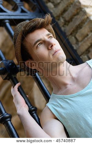 Handsome Man Wearing Sun Hat In Urban Background