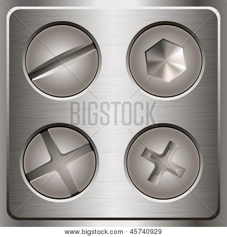 Set of screws and bolts on metal background.