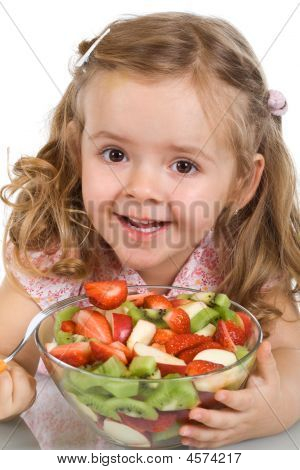 Happy Little Girl With A Bowl Of Fruit Salad