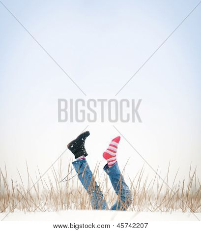 Legs With Missing Boot In Air In Winter Day.