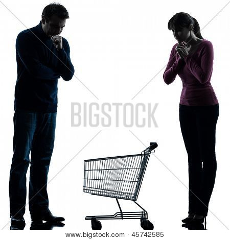 one caucasian couple woman man sad with empty shopping with shopping cart  in silhouette studio isolated on white background