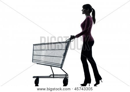 one caucasian woman with empty shopping cart in silhouette studio isolated on white background
